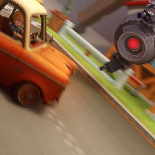 An orange car skids past a robotic flying drone