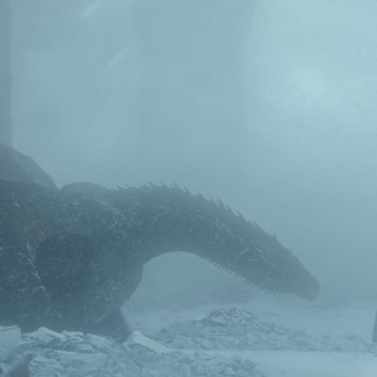 A dragon and a person in the snow from Game of Thrones