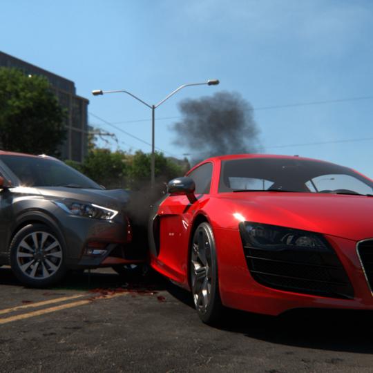 A metallic gray car crashes into a red car on a suburban street